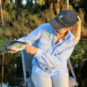 woman angler holding her crappie