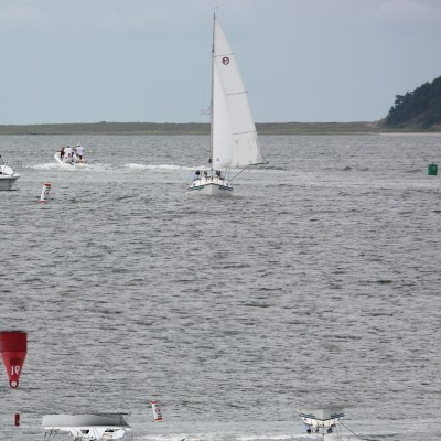 sailors practicing boat safety on the water