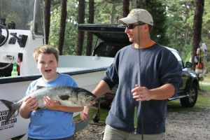 Dad and boy holding large fish
