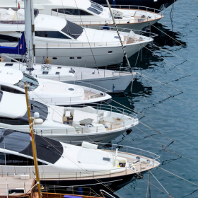 Fishing boats lined up at a boat show
