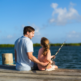 Father and daughter fishing on a lake