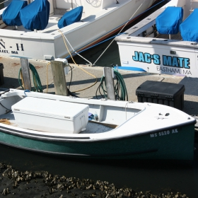 small outboard fishing boat in a marina