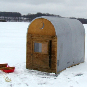 portable ice fishing shelter in the middle of a frozen lake