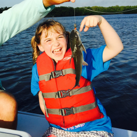 Girl angler happy about her catch