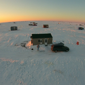 anglers out on ice with their ice fishing setup providing everything they need