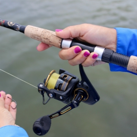 women angler using a saltwater fishing gear for beginners