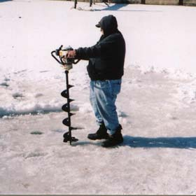 Angler drilling on ice