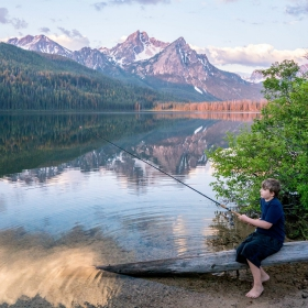 Kid fishing in Idaho Hidden Gem with his family