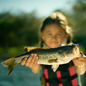 young girl holding her fish. Get your fish on