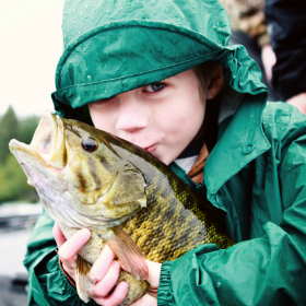 Kid kissing a bass