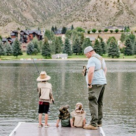 Father and kids fishing in a lake