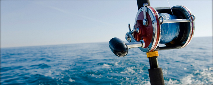 Fishing reel from a charter fishing boat on the ocean