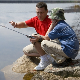 Father and son following rock fishing safety tips