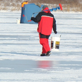 angler enjoying his ice fishing vacations