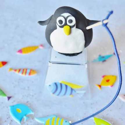 Use clay to recreate this winter penguin ice fishing scene