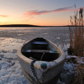 Fishing boat on an ice lake