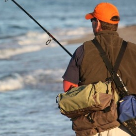 an angler goes surf fishing with all the surf fishing equipment basics checked off