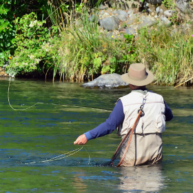 Angler fly fishing in a river