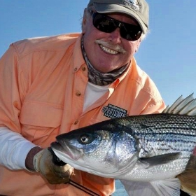 Angler who knows where to go fishing in Bay Area shows off striped bass